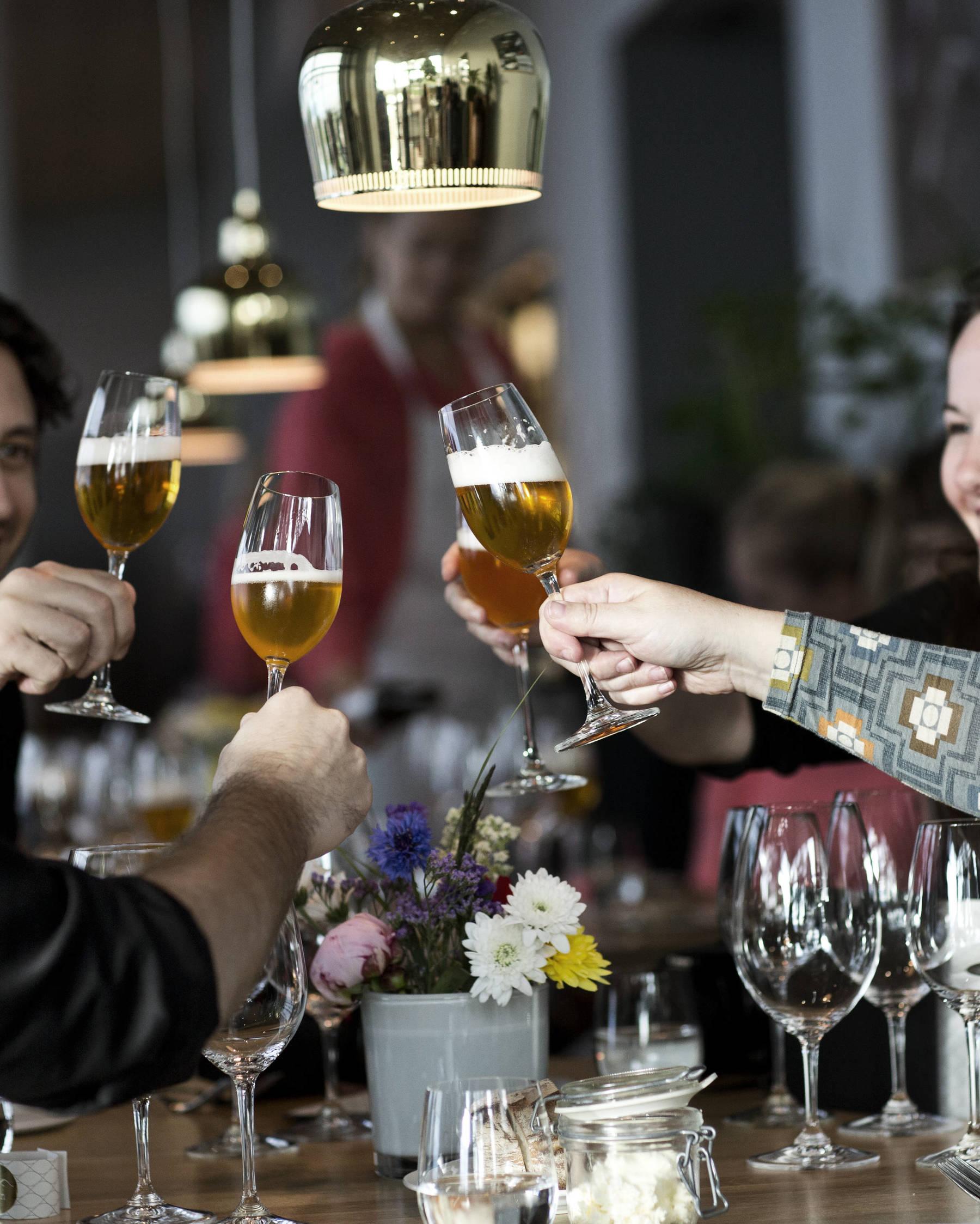 A friendly cheers at award-winning restaurant Sjön in Jönköping