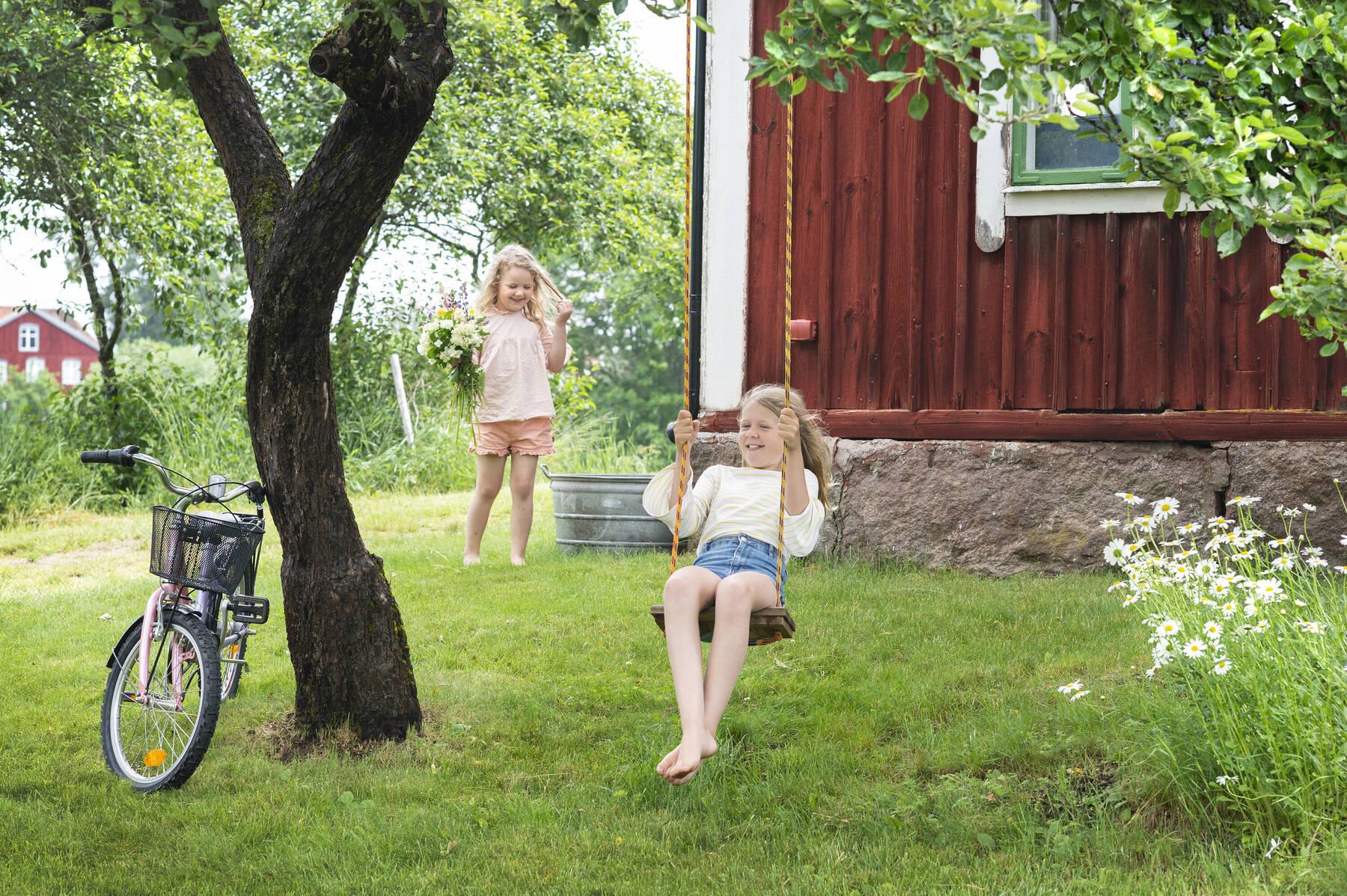 children playing in the garden in Småland, Sweden